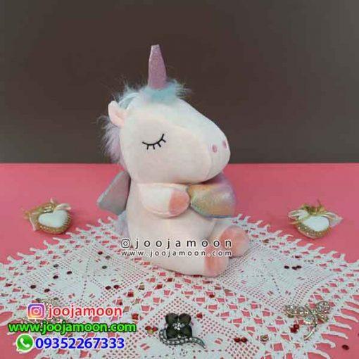 عروسک اسب تک شاخ قلب به دست بالدار